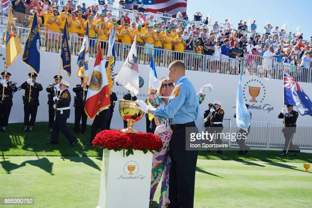 Cheryl Lee widow of Fire Captian Mark Lee Sr of Engine Company 10 and son Mark Lee Junior embrace after carrying the President's Cup trophy to the...