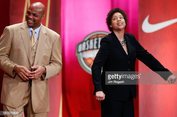Cheryl Miller and Charles Barkley share laugh as Reggie Miller speaks during the Basketball Hall of Fame Enshrinement Ceremony at Symphony Hall on...