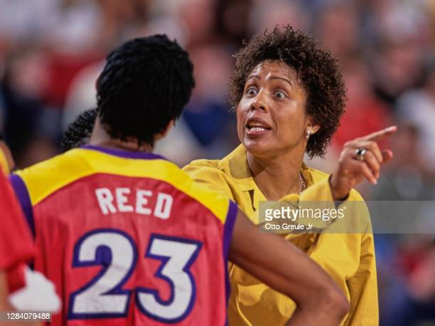 Cheryl Miller, Head Coach for the Phoenix Mercury gives instructions to Forward#23 Brandy Reed during the WNBA Western Conference basketball game...