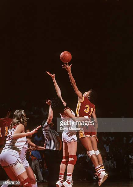 Cheryl Miller of the USC Trojans leaps for the tip off during an NCAA women's basketball game against Stanford University played during February 1983...