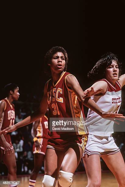 Cheryl Miller of the USC Trojans plays defense against Mary Bradach of the Stanford Cardinal during an NCAA women's basketball game against Stanford...