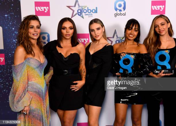 Cheryl presents Jesy Nelson Perrie Edwards LeighAnne Pinnock and Jade Thirlwall of Little Mix with the Best Group Award at the The Global Awards with...