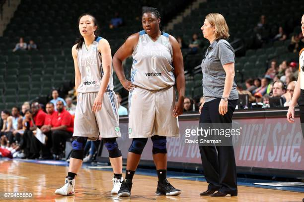 Cheryl Reeve of the Minnesota Lynx talks with Chantel Osahor and Shao Ting of the Minnesota Lynx during the game against the Atlanta Dream during the...