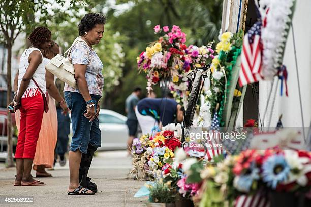 Cheryl Reifer looks at the memorial outside Emanuel AME Church JULY 31 2015 in Charleston South Carolina Earlier in the morning Dylann Roof the...