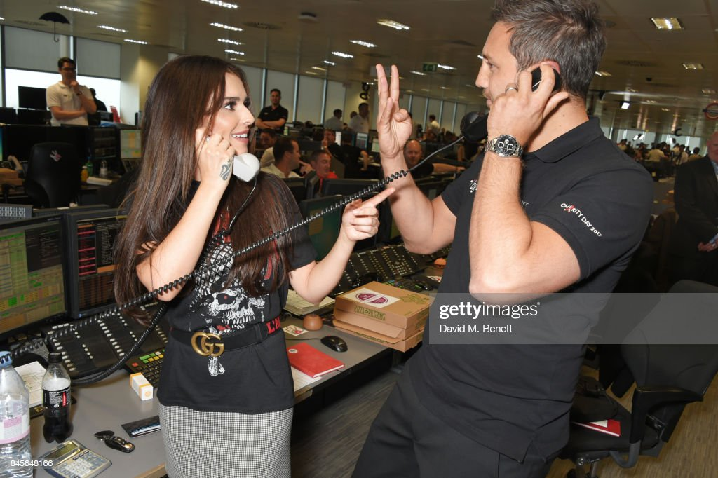 Cheryl (L), representing Cheryl's Trust, makes a trade at BGC Charity Day on September 11, 2017 in London, United Kingdom.