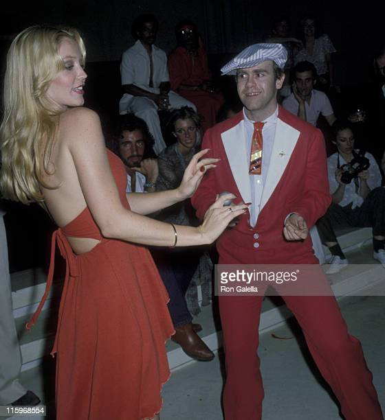 Cheryl Rixon and Elton John attend the party for Roberta Flack on June 12 1978 at Xenon Disco in New York City