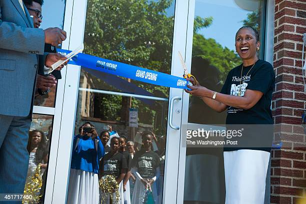 Cheryl Sanders senior pastor of the Third Street Church of God right exalts as she cuts the ribbon on the 12year $2 million renovation of the church...