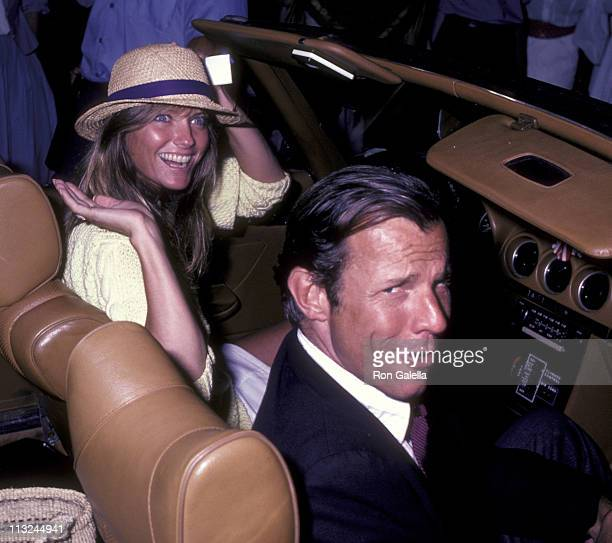 Cheryl Tiegs and Peter Beard attends SceneryGreenery Celebrity Cocktail Party on July 31 1982 at Montauk Manor in Montauk New York