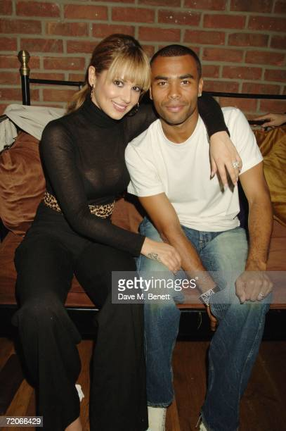 Cheryl Tweedy and her footballer husband Ashley Cole attend Jermaine Wynter's 21st birthday party at the Rex Club on October 1 2006 in London England