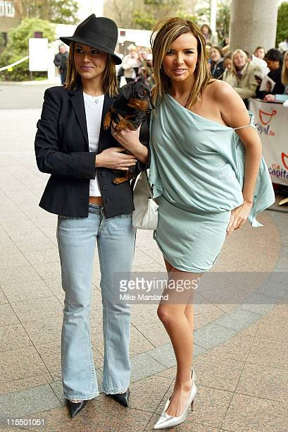 Cheryl Tweedy and Nadine Coyle from Girls Aloud during 2004 Capital FM Awards Arrivals at Royal Lancaster Hotel in London Great Britain