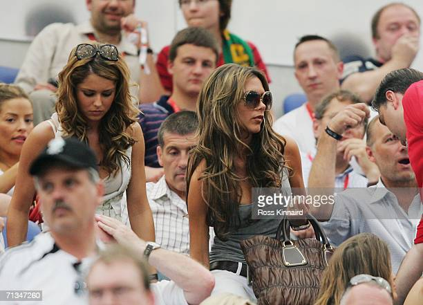 Cheryl Tweedy and Victoria Beckham take their seats prior to the FIFA World Cup Germany 2006 Quarterfinal match between England and Portugal played...