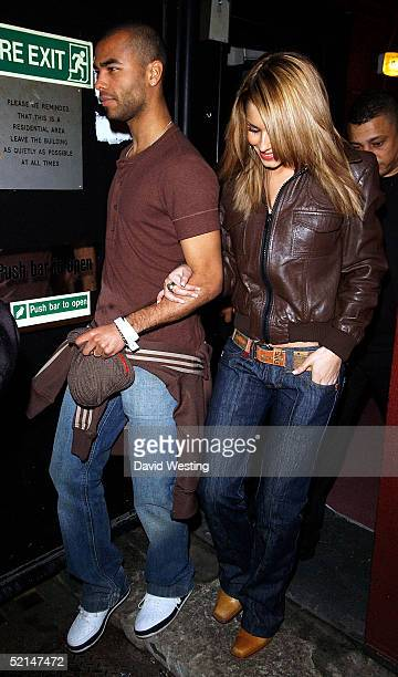 Cheryl Tweedy of Girls Aloud and Ashley Cole leave the second annual 'NFL Superbash II' at the Club Cirque on February 6 2005 in London Guests enjoy...