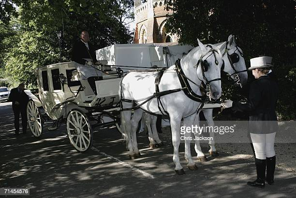 Cheryl Tweedy's horsedrawn carriage with blacked out windows sits outside Wrotham church where she is getting married to Ashley Cole on July 15 2006...