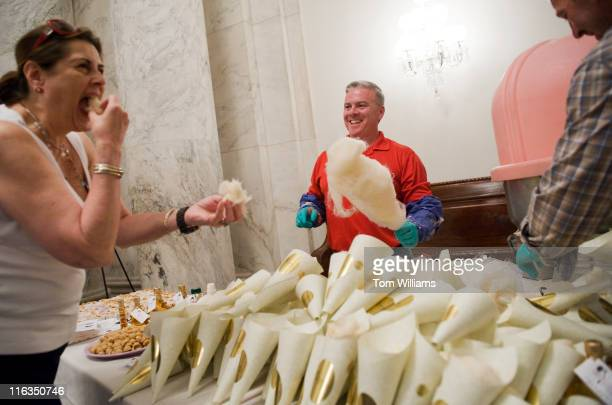 Cheryl Walsh of FIRST a robotic competition organization based in Manchester NH samples maple flavored cotton candy from Sweet Water Maple in Candia...