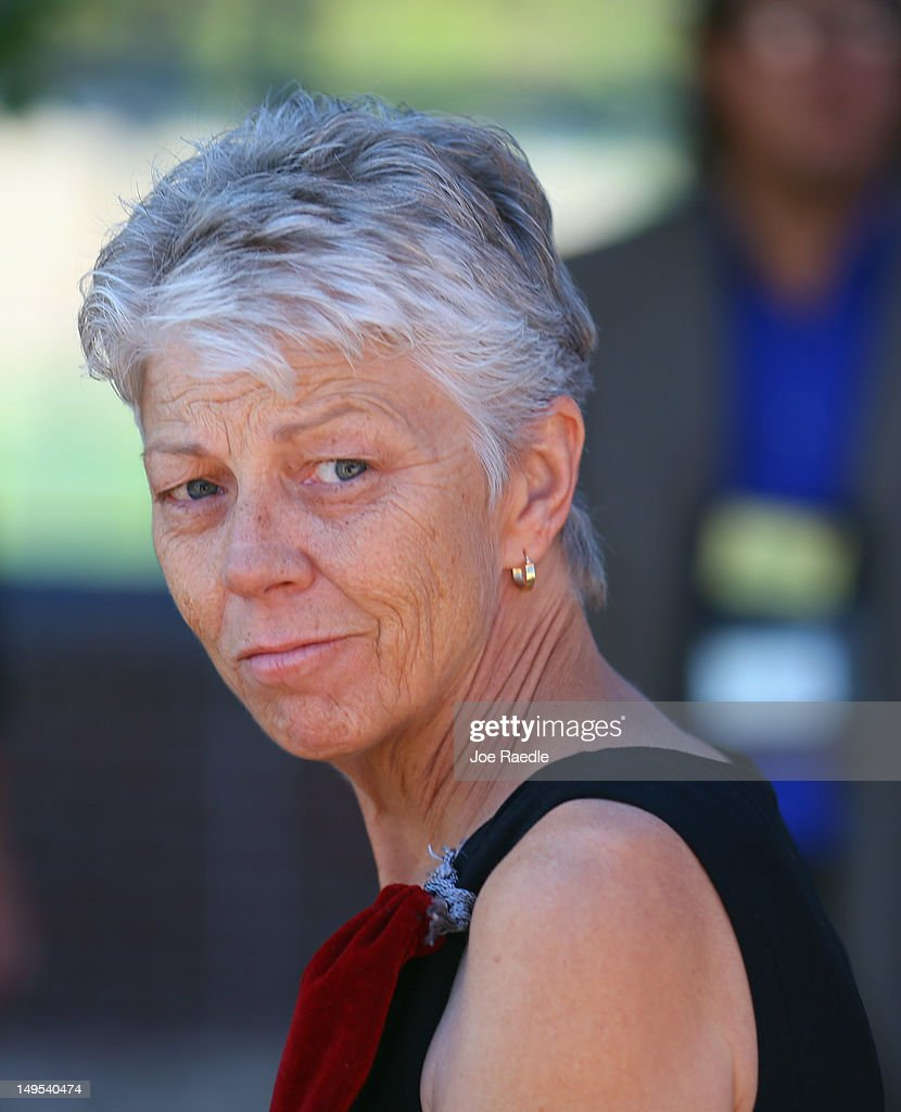 Cheryl Wygal, the mother of Rebecca Wingo, who was killed during the shooting at the screening of The Dark Knight Rises leaves the Arapahoe County Courthouse after attending an arraignment hearing for suspect James Holmes on July 30, 2012 in Centennial, Colorado. James Holmes, 24, who is accused of killing 12 people and injuring 58 in a shooting spree July 20, during a screening of 'The Dark Knight Rises.' in Aurora, Colorado was charged with 24 counts of first-degree murder and 116 counts of attempted murder.