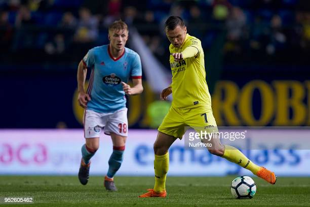 Cheryshev of Villarreal CF with the ball next to Daniel Wass of Real Club Celta de Vigo during the La Liga game between Villarreal CF and Real Club...