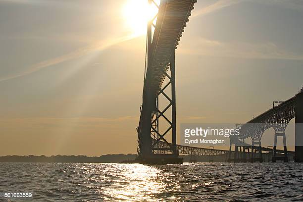 chesapeake bay bridge silhouetted by sun - chesapeake bay bridge stock pictures, royalty-free photos & images