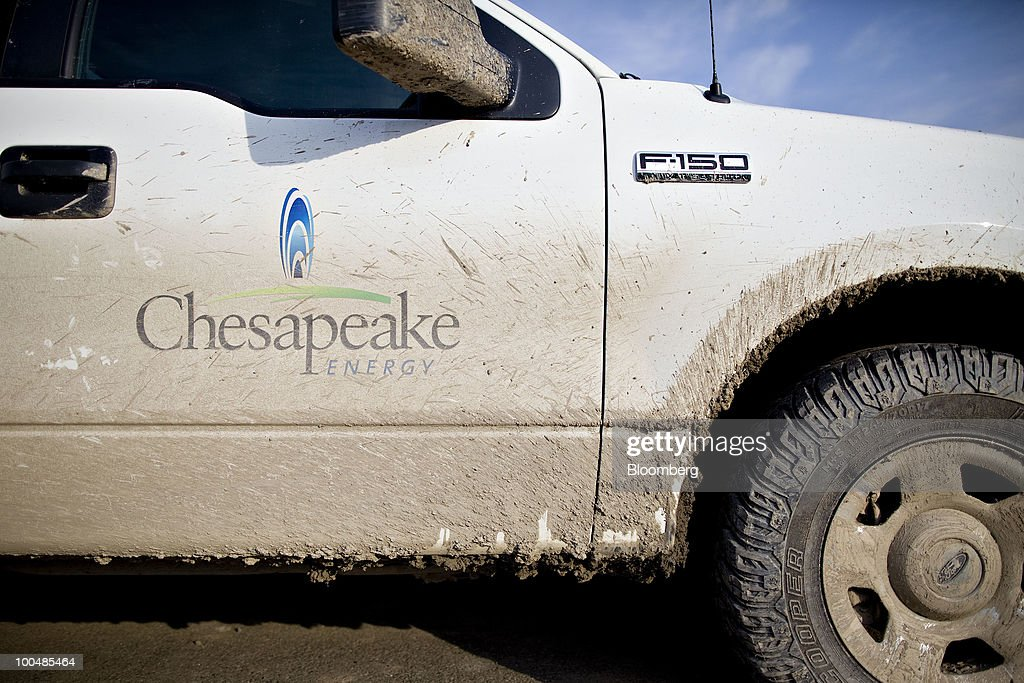 A Chesapeake Energy Corp. truck sits outside a Chesapeake field office in Towanda, Pennsylvania, U.S., on Tuesday, April 6, 2010. Companies are spending billions to dislodge natural gas from a band of shale-sedimentary rock called the Marcellus shale that underlies Pennsylvania, West Virginia and New York. The band of rock, so designated because it pokes through near a city of that name in northern New York, may contain 262 trillion cubic feet of recoverable gas, the U.S. Department of Energy estimates. Photographer: Daniel Acker/Bloomberg via Getty Images