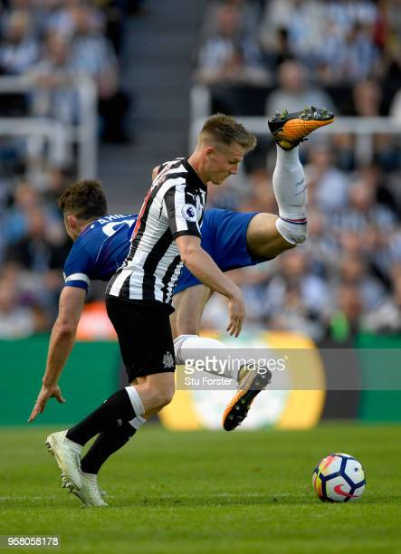 Chesea defender Gary Cahill challenges Matt Ritchie of Newcastle during the Premier League match between Newcastle United and Chelsea at St James...