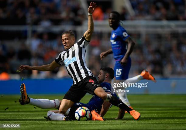 Chesea defender Gary Cahill fouls Dwight Gayle of Newcastle during the Premier League match between Newcastle United and Chelsea at St James Park on...