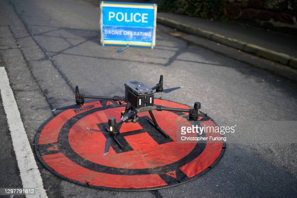 Cheshire police use their drone to survey floodwater as it begins to recede from the village of Farndon, Cheshire, in the aftermath of Storm...