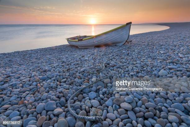 chesil beach sunset - pebble stock photos and pictures
