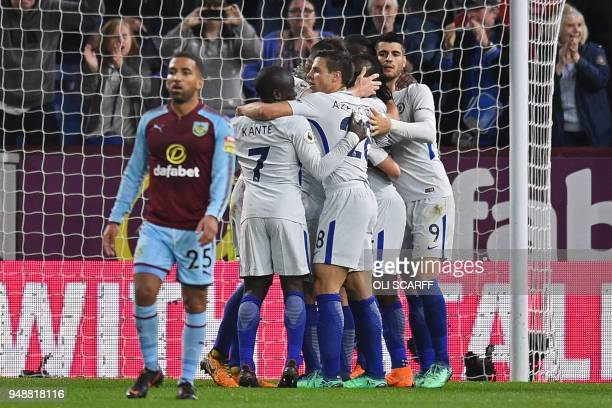 Cheslea's players celebrate with Chelsea's Nigerian midfielder Victor Moses after he scores their winning goal during the English Premier League...