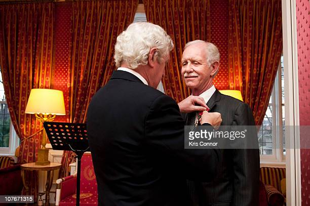 Chesley Sullenberger is presented with the Officier Award by French ambassador to the United States Pierre Vimont during a presentation at the French...