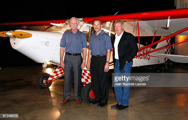 Chesley Sully Sullenberger Jeffrey Skiles and Harrison Ford attend the Harrison Ford EAA Young Eagles press conference at the Santa Monica Airport on...