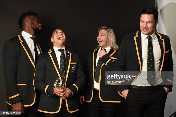 Cheslin Kolbe and Faf De Klerk of the South African Rugby Union team winners of the Laureus World Team of the Year laugh backstage during the 2020...