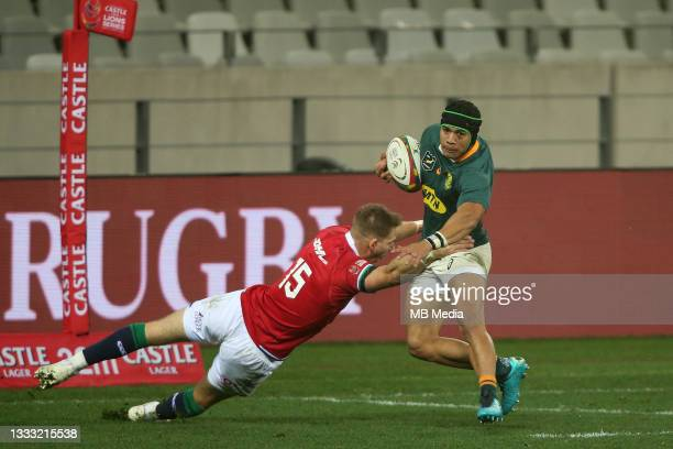 Cheslin Kolbe of South Africa attempts to get past Liam Williams of the British & Irish Lions during the 3rd Test between South Africa and the...