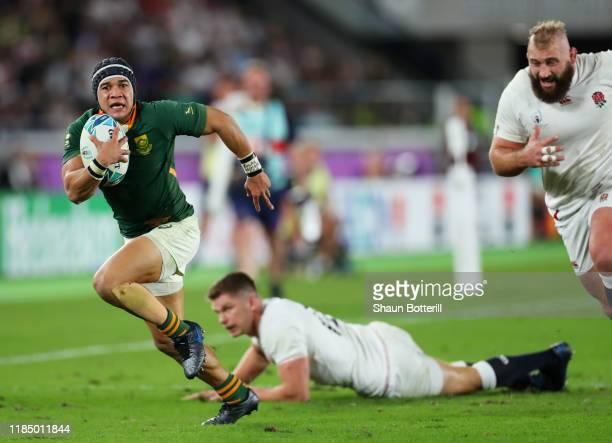 Cheslin Kolbe of South Africa beats of Owen Farrell and Joe Marler of England to score his team's second try during the Rugby World Cup 2019 Final...