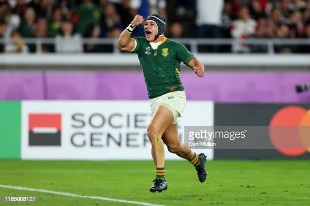 Cheslin Kolbe of South Africa celebrates after scoring his team's second try during the Rugby World Cup 2019 Final between England and South Africa...