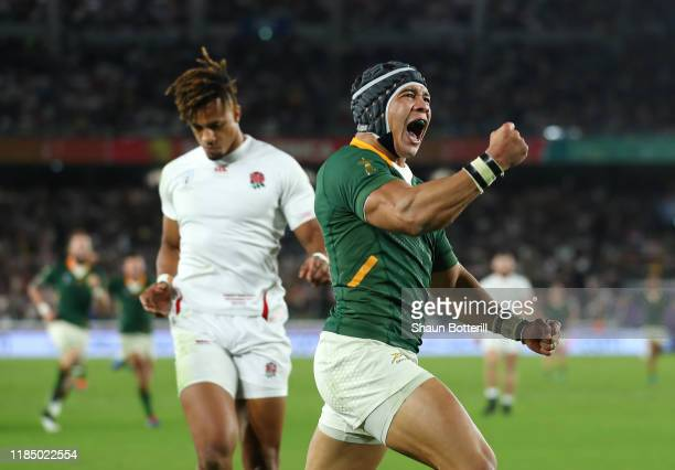 Cheslin Kolbe of South Africa celebrates after scoring the second try as Anthony Watson of England looks dejected during the Rugby World Cup 2019...