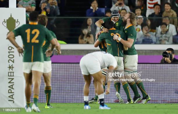 Cheslin Kolbe of South Africa celebrates with team mates Handre Pollard RG Snyman and Franco Mostert of South Africa after scoring their team's...