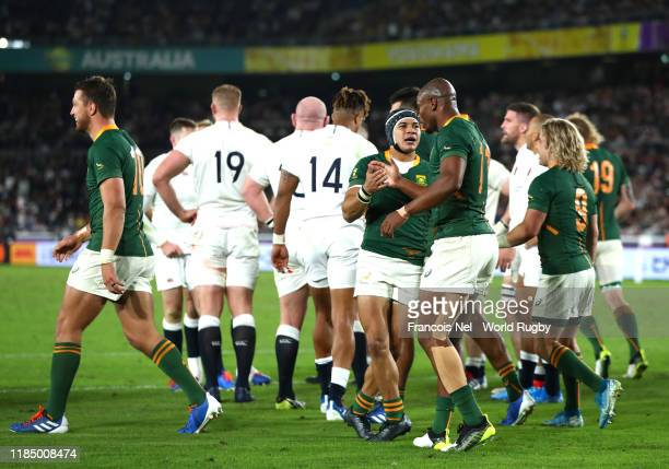 Cheslin Kolbe of South Africa celebrates with teammate Makazole Mapimpi after scoring his team's second try during the Rugby World Cup 2019 Final...