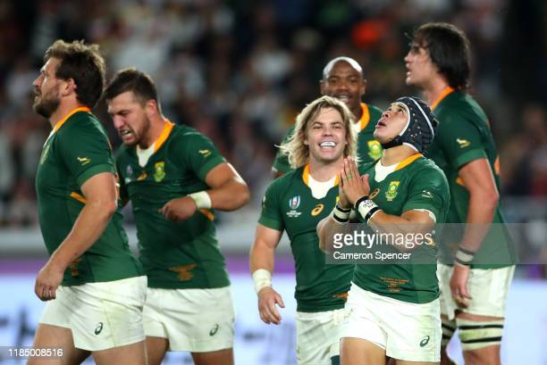Cheslin Kolbe of South Africa celebrates with teammates after scoring his team's second try during the Rugby World Cup 2019 Final between England and...