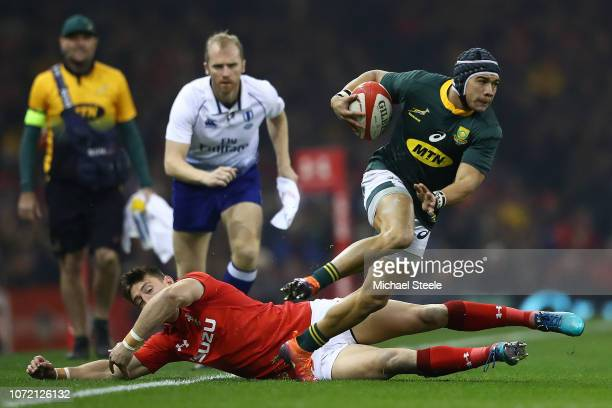 Cheslin Kolbe of South Africa evades the challenge from Josh Adams of Wales during the International Friendly match between Wales and South Africa at...