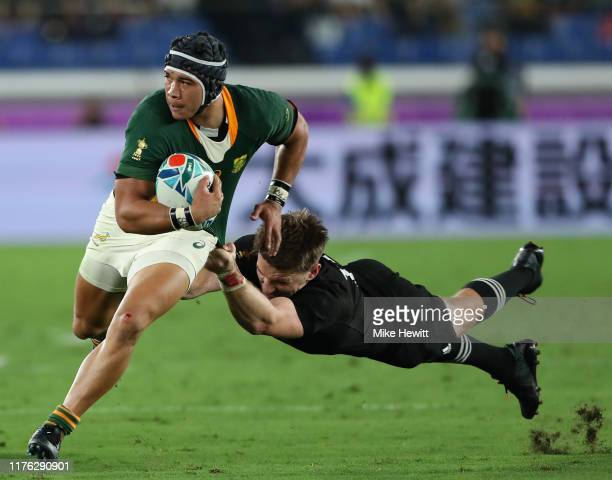 Cheslin Kolbe of South Africa gets past the tackle of Beauden Barrett of New Zealand during the Rugby World Cup 2019 Group B game between New Zealand...