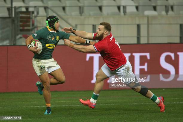 Cheslin Kolbe of South Africa hands off Luke Cowan-Dickie of the British & Irish Lions during the 3rd Test between South Africa and the British &...