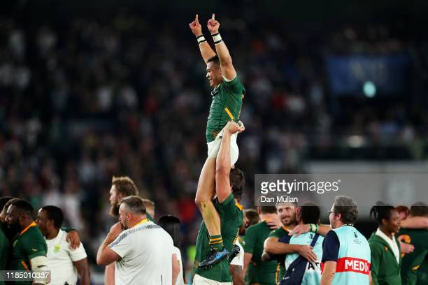Cheslin Kolbe of South Africa is lifted by Eben Etzebeth of South Africa as they celebrate victory over England following the Rugby World Cup 2019...