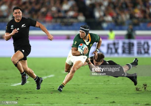 Cheslin Kolbe of South Africa is tackled by Beauden Barrett of New Zealand during the Rugby World Cup 2019 Group B game between New Zealand and South...