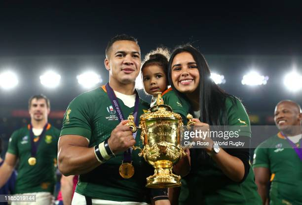 Cheslin Kolbe of South Africa poses with the Web Ellis cup and family following his team's victory against England in the Rugby World Cup 2019 Final...