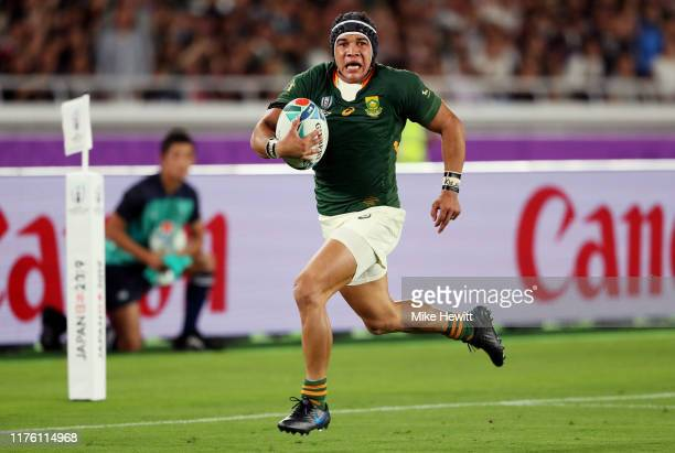 Cheslin Kolbe of South Africa runs with the ball during the Rugby World Cup 2019 Group B game between New Zealand and South Africa at International...