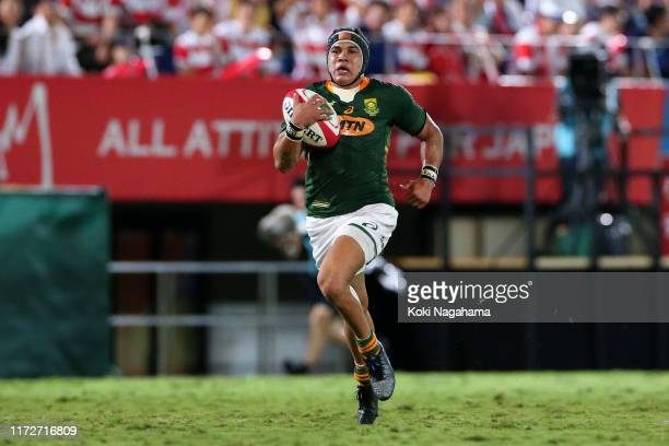 Cheslin Kolbe of South Africa runs with the ball to score his side's fifth try during the international match between Japan and South Africa at...