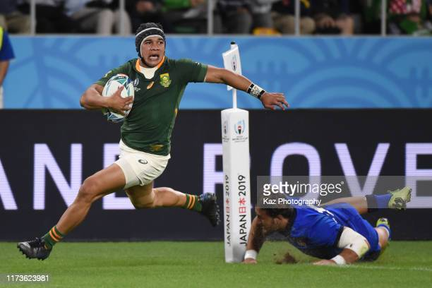 Cheslin Kolbe of South Africa scores 3rd try while Michele Campagnaro of Italy tackles during the Rugby World Cup 2019 Group B game between South...