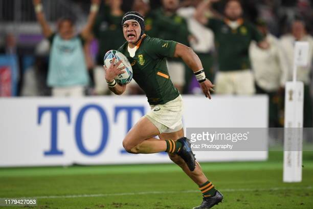 Cheslin Kolbe of South Africa scores his team's second try during the Rugby World Cup 2019 Final between England and South Africa at International...
