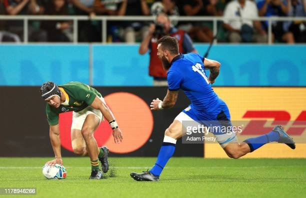 Cheslin Kolbe of South Africa scores his team's third try during the Rugby World Cup 2019 Group B game between South Africa v Italy at Shizuoka...