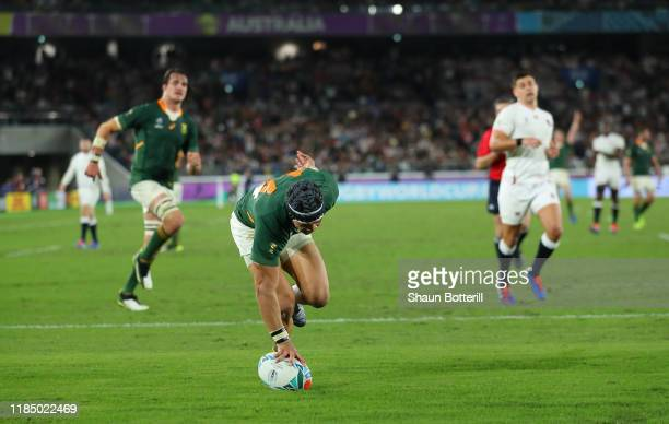 Cheslin Kolbe of South Africa scores the second try during the Rugby World Cup 2019 Final between England and South Africa at International Stadium...