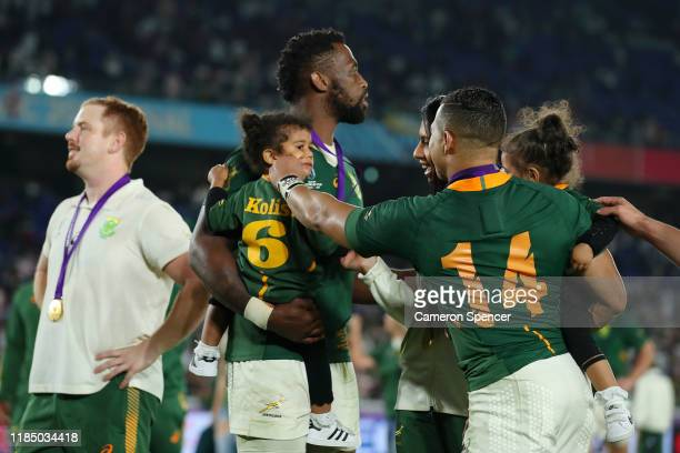 Cheslin Kolbe of South Africa shares a joke with Keziah Kolisi the daughter of Siya Kolisi of South Africa during a lap of honor following their...